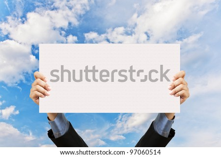 businessman holding blank sign and hand in sky - stock photo