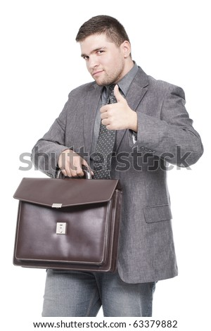 businessman holding briefcase with thumb up - stock photo