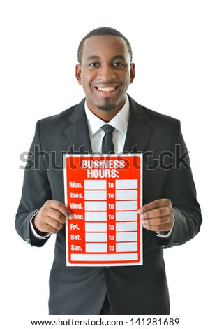 Businessman holding business hours sign - stock photo