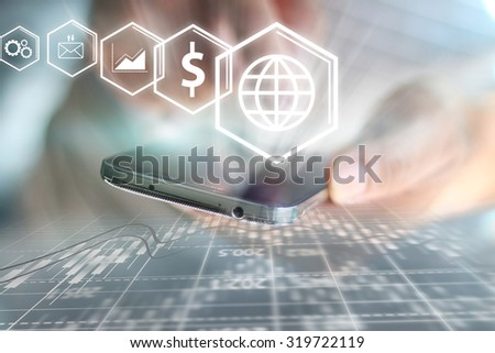 Businessman holding business icons. - stock photo