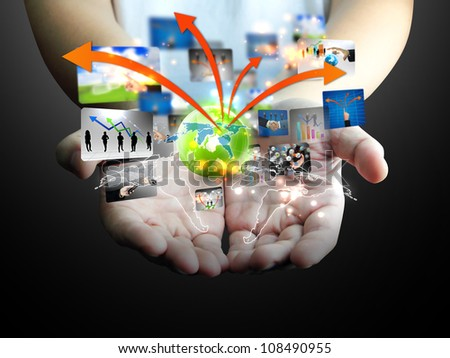 Businessman holding business world - stock photo