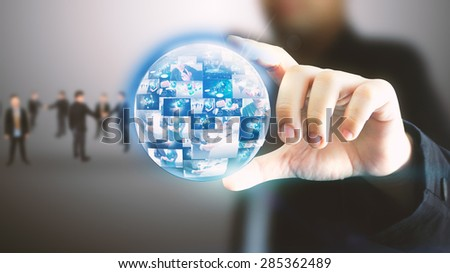 Businessman holding business world. - stock photo
