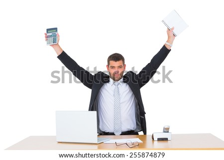 Businessman holding calculator and diary at his desk - stock photo