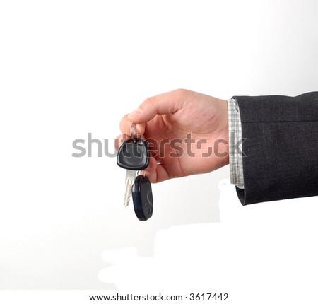 businessman holding car key - stock photo
