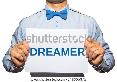 Businessman holding card Dreamer isolated on white background - stock photo
