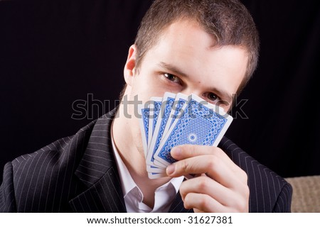 Businessman holding cards - stock photo