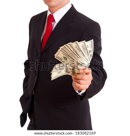 Businessman holding cash dollars in hands of passing them to the client. Concept of finance success. Isolated, space for text