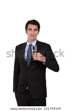 Businessman holding champagne glass - stock photo