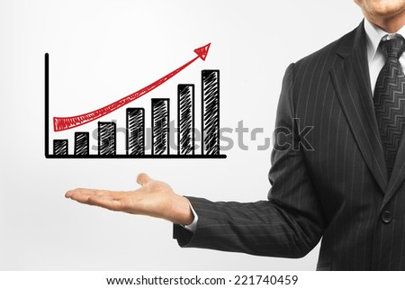 businessman holding chart on a white background