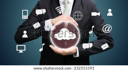 Businessman holding cloud computing network on dark background - stock photo
