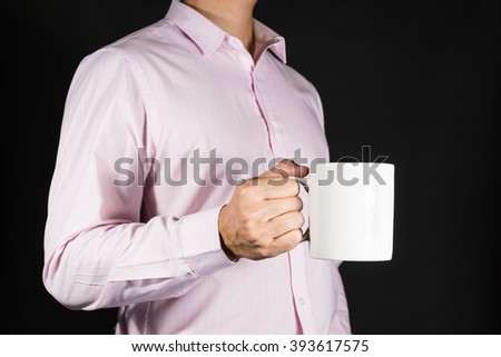 Businessman Holding coffee mug with copy space