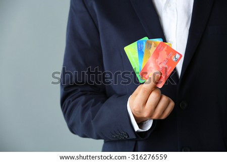 Businessman holding credit card,  close-up - stock photo