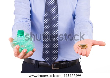 Businessman holding crushed bottle and coins. - stock photo