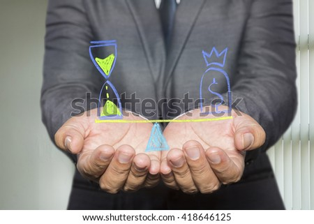 Businessman holding diagram with Scales in equal balance holding a clock left on the and money on the right. - stock photo