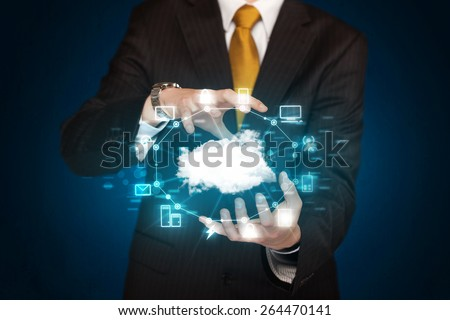 Businessman holding digital icons, Cloud computing concept - stock photo