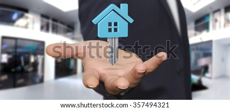 Businessman holding digital key flying over his hand - stock photo