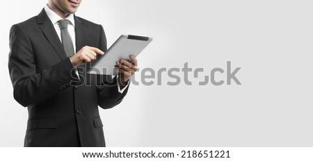 businessman holding digital tablet, close up - stock photo