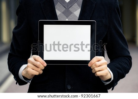 Businessman holding digital tablet pc with blank screen. - stock photo