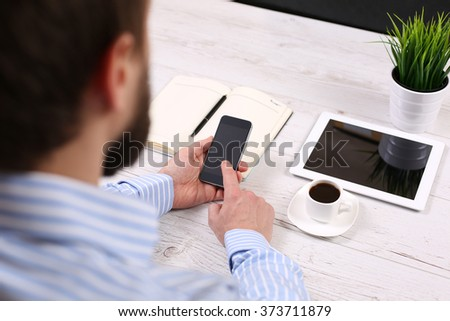 Businessman holding digital tablet with blank screen in coffee s - stock photo