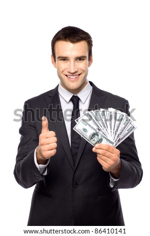 Businessman holding dollar bills - stock photo