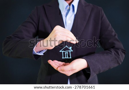 Businessman holding drawing house - stock photo