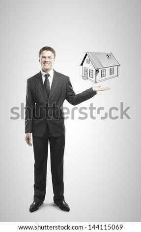 businessman holding drawing house on a white background
