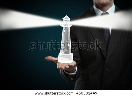 businessman holding drawing lighthouse in hand - stock photo