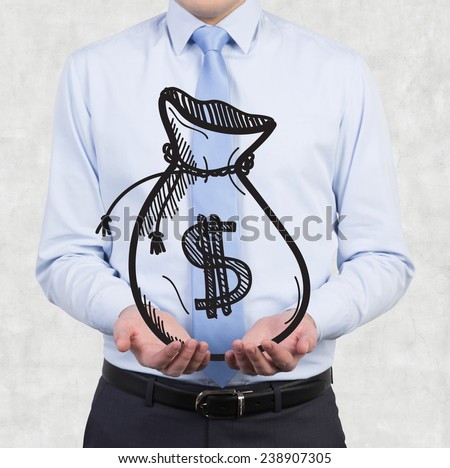 businessman holding drawing money bags in hand - stock photo
