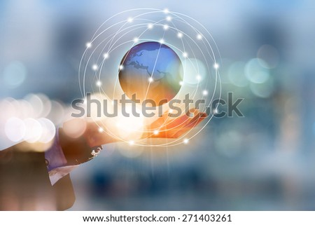Businessman holding earth - stock photo