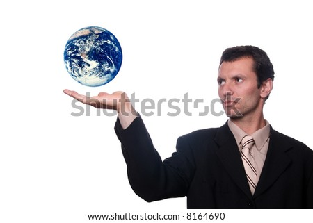 businessman holding earth (protect) - stock photo