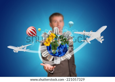 Businessman holding earth with buildings. Element of this image furnished by NASA - stock photo