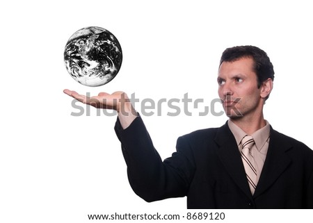 businessman holding earth with polution and war efects - stock photo