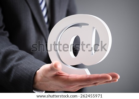 Businessman holding email at symbol concept for internet, contact and e-mail address - stock photo
