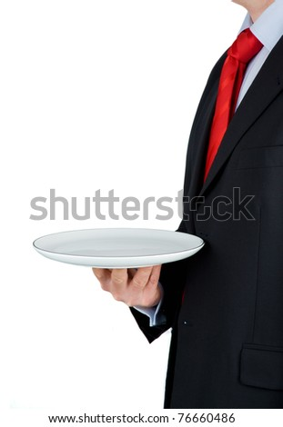 Businessman holding empty plate isolated on white