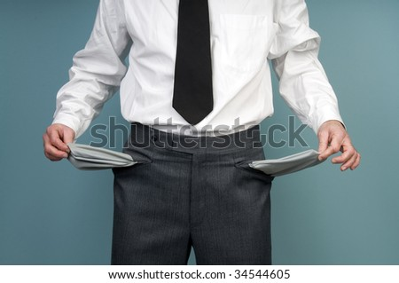 Businessman holding empty pockets