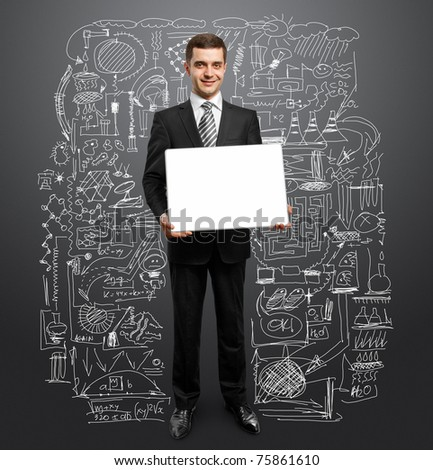 businessman holding empty write board in his hands - stock photo