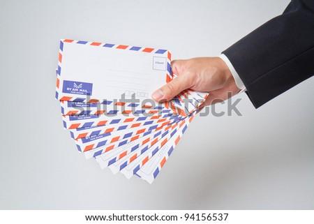 Businessman holding  envelope - stock photo