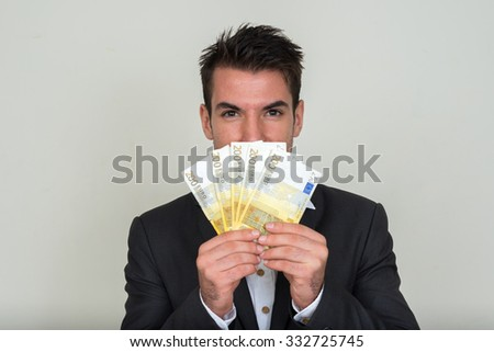 Businessman holding 200 euro money in his hands - stock photo