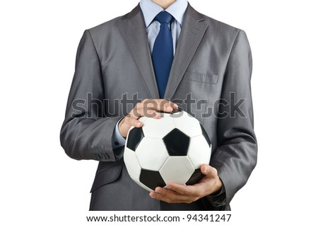 Businessman holding football on white - stock photo