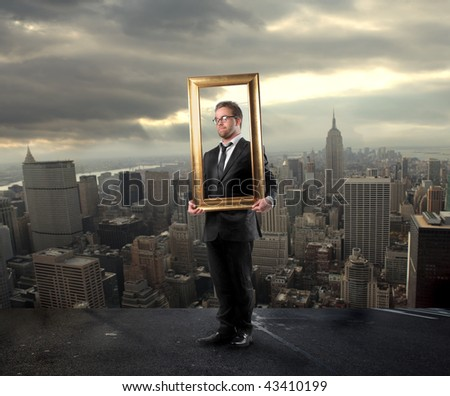 businessman holding frame and NY city on the background - stock photo