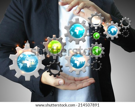 Businessman holding gears,networking - stock photo