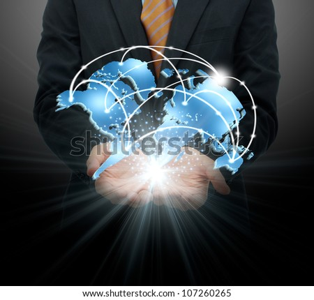 Businessman holding global business - stock photo