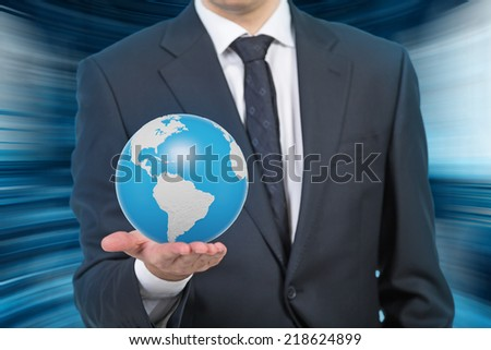 Businessman holding globe, America view. Elements of this image furnished by NASA