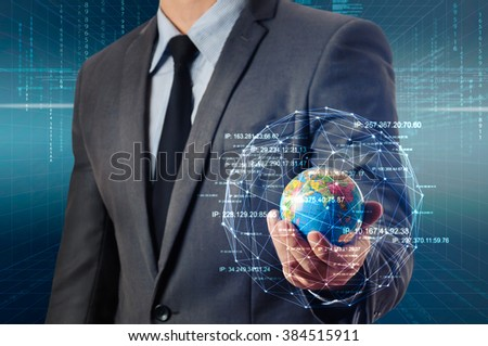 businessman holding globe surrounding by glow network - stock photo