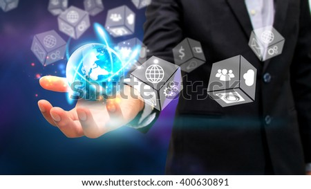 Businessman holding glowing globe with Social media icons. - stock photo