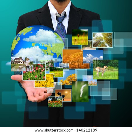 businessman holding green Earth in hands and Reaching images streaming .Environmental concept - stock photo