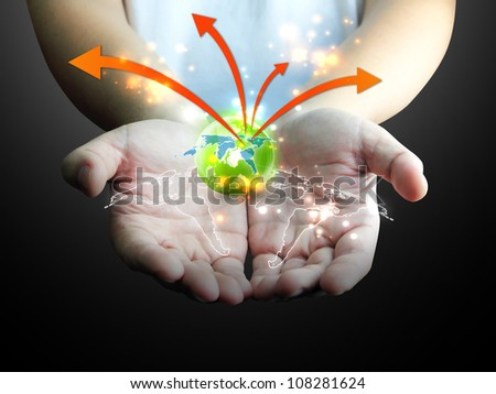 businessman holding green globe