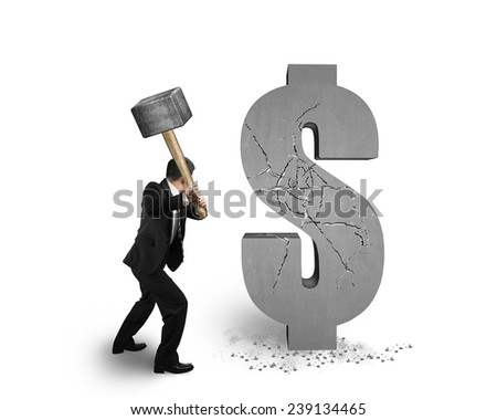 businessman holding hammer hitting cracked dollar sign isolated on white background - stock photo