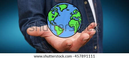 Businessman holding hand drawn planet earth in his hand