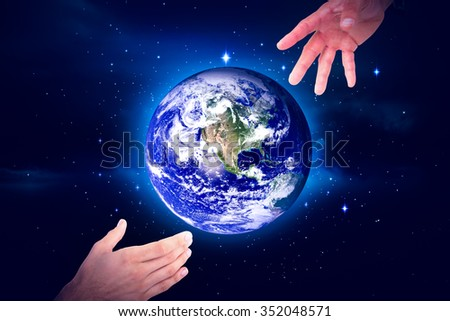 Businessman holding hand out in presentation against stars twinkling in night sky - stock photo